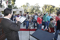 """Johnny Hochgraefe sings """"All Creatures Great and Small"""" as members of the San Diego Dachshund Club and their dogs  parade across the stage at the Spreckels Organ stage in Balboa Park, San Diego California, December 23rd, 2007."""