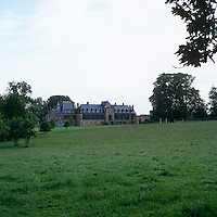 The multi-windowed facade of Chateau de Montigny was built in the mid-1700s and offers views of the grounds planted in the English landscape style