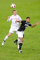 Michael Millay (8) of the Cincinnati Bearcats and Greg Davis (14) of the Providence Friars go up for a header. The Providence Friars defeated the Cincinnati Bearcats 2-1 during the semi-finals of the Big East Men's Soccer Championship at Red Bull Arena in Harrison, NJ, on November 12, 2010.