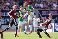 Fussball 1. Bundesliga   Saison  2012/2013   34. Spieltag   1. FC Nuernberg - SV Werder Bremen       18.05.2013 Clemens Fritz (Mitte, SV Werder Bremen) gegen Sebastian Polter (re, 1. FC Nuernberg) und Tomas Pekhart (li, 1. FC Nuernberg)