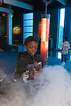 Oakland CA 2nd grade boy on school field trip to Chabot Space and Science Center studying cloud made of water droplets