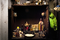 The Palo home altar, containing magical objects of the Palo religion together with Christian figures, seen in the house of a Palo follower in Santiago de Cuba, Cuba, August 3, 2009. The Palo religion (Las Reglas de Congo) belongs to the group of syncretic religions which developed in Cuba amongst the black slaves, originally brought from Congo during the colonial period. Palo, having its roots in spiritual concepts of the indigenous people in Africa, worships the spirits and natural powers but can often give them faces and names known from the Christian dogma. Although there have been strong religious restrictions during the decades of the Cuban Revolution, the majority of Cubans still consult their problems with practitioners of some Afro Cuban religion.