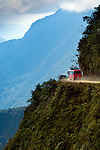 A support van for bicyclists makes its way around a hairpin turn on The World's Most Dangerous Road or The Road Of Death, a 43 mile mountain road leading from La Paz to Coroico in the Yungas region of Bolivia.  The road known for its extreme dropoffs, narrow widths and turns, has been responsible for many accidents.  It is now a popular tourist destination for mountain bikers.