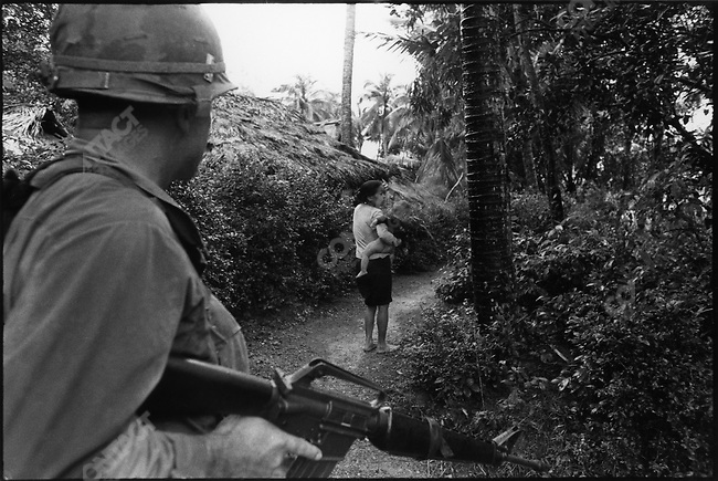 US soldiers on patrol, A Shau Valley, South Vietnam, December 1967