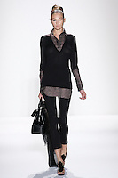 Model walks runway an EBONY SILK +CASHMERE HANDLOOMED V-NECK TUNIC W/ATTACHED SILK GAZAR LINEN AND SHIRT TAIL, AND  EBONY SILK+CASHMERE HANDLOOMED LEGGINGS by Zang Toi, for the Zang Toi Spring 2012 My Dream Of North Africa Collection, during Mercedes-Benz Fashion Week Spring 2012.