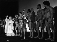 "Actress Mae West with muscle builders at the Warfield Theater in San Francisco, Calif for the opening of ""Sextette"" musical comedy her first movie since Myra Breckenridge in 1970."
