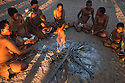 Botswana, Kalahari, bushman (San) women and children gathered around fire