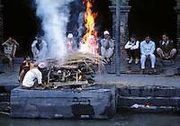 A human body is CREMATED along the BAGMATI RIVER at the Hindu Temple compex of PASHUPATINATH - KATHAMNDU, NEPAL