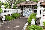 Sanur Beach, Bali, Indonesia; the ornate entrance door to La Taverna from the boardwalk along the beach