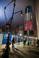 The under construction One World Trade Center is illuminated in red, white and blue lights for the tenth anniversary of the September 11 terrorist attacks in New York, seen on Sunday, September 11, 2011. (© Richard B. Levine)