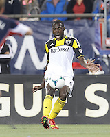 Columbus Crew midfielder Tony Tchani (6) passes the ball.  In a Major League Soccer (MLS) match, the New England Revolution (blue) defeated Columbus Crew (white), 3-2, at Gillette Stadium on October 19, 2013.