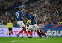 Yann Mvila of France, Jozy Altidore of team USA and Laurent Koscielny of France fight for the ball during the friendly match France against USA at the Stade de France in Paris, France on November 11th, 2011.