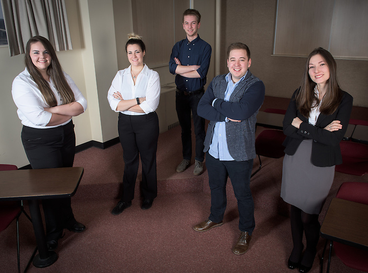 From left, Lori Bentz, Baylie Pollock, Ben Bowald,  Colin Espinosa and Faith Voinovich of the C-Suite Student Entrepreneurship Team meet in the a Central Classroom Building on West Union Street on February 1, 2017.