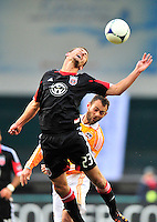 Perry Kitchen of United goes for header. Houston ousted D.C. United from the MLS Cup Final with a 1-1 tie at the RFK Stadium in Washington, D.C. on Sunday, November 19, 2012.  Alan P. Santos/DC Sports Box