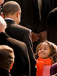 Sasha Obama looks up at her father, Barack Obama, left, during his inauguration as the 44th U.S. President at the U.S. Capitol in Washington, D.C., Tuesday, January 20, 2009. (Brian Baer/Sacramento Bee/MCT)