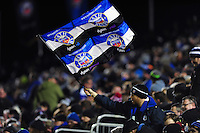 A Bath Rugby fan in the crowd waves a flag in support. Aviva Premiership match, between Bath Rugby and Newcastle Falcons on March 18, 2016 at the Recreation Ground in Bath, England. Photo by: Patrick Khachfe / Onside Images