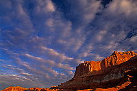 731350057 afternoon clouds form up over brilliant red sandstone formations and the waterpocket fold in capitol reef national park utah