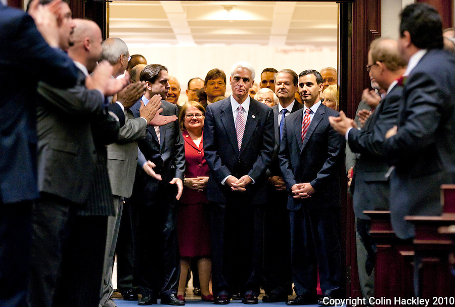 TALLAHASSEE, FLA. 3/2/10-OPENING DAY CH50-Gov. Charlie Crist, center, pauses as members of the House and Senate applaud his entrance for his last State of the State speech on the opening day of the legislative session, Tuesday at the Capitol in Tallahassee...COLIN HACKLEY PHOTO