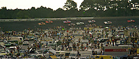 Cars race past the packed infield at the Firecracker 400 at Daytona International Speedway in Daytona Beach, Florida on July 4, 1977. (Photo by Brian Cleary/www.bcpix.com)