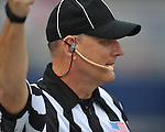 An official wears a headset at Ole Miss football practice a Vaught-Hemingway Stadium in Oxford, Miss. on Saturday, August 18, 2012.