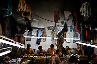 Artisanal gold smiths in Kolkata (Calcutta). These guys make about 3-400 USD a month at the top end.  They live in the workplace and the clothes hanging above them are their clothes, their closet as it were.  At night they move the worktables aside and sleep on the floor and there are a few other places for them to crowd in to......BUT... you have to be careful with cultural stigmas.  These guys are all very kind to each other, they are from the same village.  They rotate who goes out for food, for tea.  They take care of each other and they NEED each other.  When one of them goes back to the village, he carries the money from all of them.  When he comes back he brings things to them from all of their families...The goldsmiths are give 102.6 grams of gold and are expected to return 100 grams of jewelry.  The average waste for 100 grams is 1.3 grams.  So the owner of the factory tells them he wants a 20 gram piece of jewelry and they have to figure out how to make it that weight and keep to the design they are given.