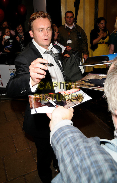 PHILLIP GLENISTER .The TVQuick & TV Choice Awards, Dorchester Hotel, London, England..September 8th, 2008.tv quick choice full length black suit philip signing autographs .CAP/CAN.©Can Nguyen/Capital Pictures.