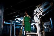 Factory worker, Indrey Sarki at the drying machine at Makaibari Tea Estate factory, Kurseong in Darjeeling, India.