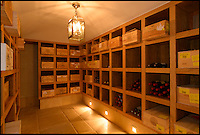 BNPS.co.uk (01202 558833)<br /> Pic: Strutt&amp;Parker/BNPS<br /> <br /> ***Please use full byline***<br /> <br /> Wine Cellar.<br /> <br /> Field House near Ablington and built in the classic Cotswold style. is on the market for &pound;4m.<br /> <br /> To the Manor Reborn...<br /> <br /> Britain's super rich are turning their backs on the decaying stately piles beloved by the aristocracy and building brand new modern mansions on their country estates.<br /> <br /> Rather than investing in the leaky roofs and draughty windows of days gone by, modern millionaires are choosing to build plush pads from the ground up.<br /> <br /> And they are filling their dream homes with every conceivable luxury without the need for a bottomless sink fund to pay for the costly upkeep of older houses.<br /> <br /> Estate agents specialising in top-end properties have reported a clear swing from grand Victorian manor houses to state of the art modern homes kitted out with all the mod cons.<br /> <br /> The multi-million pounds properties have been popping up across the country over the past few years - and are now being heralded as the stately homes of the future.