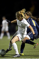 """Boston College forward Kristen Mewis (19) attempts to control the ball as West Virginia forward Frances Silva (9) pressures. Boston College defeated West Virginia, 4-0, in NCAA tournament """"Sweet 16"""" match at Newton Soccer Field, Newton, MA."""