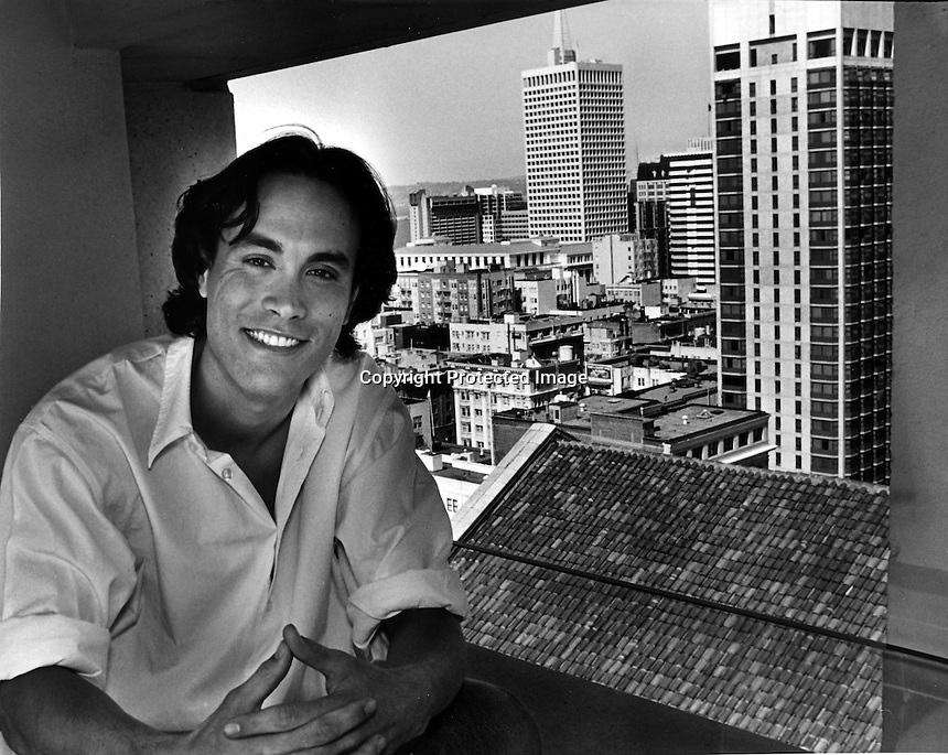 Actor Brandon Lee interview in a room overlooking San Francisco. Lee was killed months later in film accident. (1992 photo by Ron Riesterer)