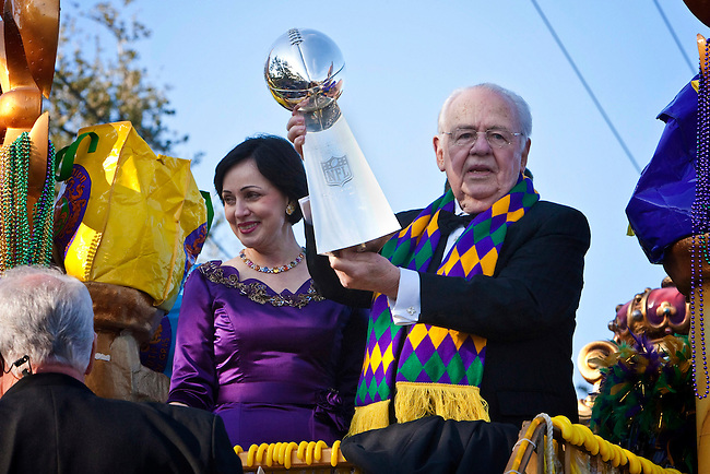 New Orleans Saints owner Tom Benson holding the Vince Lombardi Trophy for the New Orleans Saints Superbowl XLIV win accompanied by his wife Gayle as they ride in the Krewe of Endymion parade down Orleans Avenue in New Orleans, Louisiana. USA