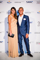 SURFERS PARADISE, Queensland/Australia (Friday, March 1, 2013) Mick Fanning (AUS) with wife Karrisa Fanning (AUS). - The world's best surfers congregated last night at the QT Hotel in Surfers Paradise to celebrate the 2013 ASP World Surfing Awards, officially crowning last year's ASP World Champions and welcoming in the new year..Joel Parkinson (AUS), 31, long considered to be a threat to the ASP World Title ever since his inception amongst the world's elite over a decade ago, was awarded his maiden crown last night. Amidst a capacity crowd of the world's best surfers and hometown supporters, the Gold Coast stalwart brought the house down with a heartfelt and emotional speech..?It's beautiful to have everyone here tonight,? Parkinson said. ?We all come together and really celebrate last season amongst our friends and family. The new year, for me, begins tomorrow. Tonight, I just feel so fortunate to be up here and to be supported by my beautiful family. I love them and am only here because of them.?.FULL LIST OF AWARDS' RECIPIENTS:.2012 ASP World Champion: Joel Parkinson (AUS).2012 ASP World Runner-Up: Kelly Slater (USA).2012 ASP Rookie of the Year: John John Florence (HAW).2012 ASP Women's World Champion: Stephanie Gilmore (AUS).2012 ASP Women's World Runner-up: Sally Fitzgibbons (AUS).2012 ASP Women's Rookie of the Year: Malia Manuel (HAW).2012 ASP Breakthrough Performer: Sebastian Zietz (HAW).2012 ASP Women's Breakthrough Performer: Lakey Peterson (USA).2012 ASP World Longboard Champion: Taylor Jensen (USA).2012 ASP Women's World Longboard Champion: Kelia Moniz (HAW).2012 ASP World Junior Champion: Jack Freestone (AUS).2012 ASP Women's World Junior Champion: Nikki Van Dijk (AUS).ASP Life Member/Chairman Emeritus: Richard Grellman.ASP Service to the Sport: Randy Rarick.Peter Whittaker Award: Adrian Buchan.2012 ASP Men's Heat of the Year (Fan Vote): Mick Fanning (AUS) vs. Kelly Slater (USA) - Rip Curl Pro Bells Beach.2012 ASP Women's Heat of the Year (Fan Vote): La