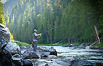 Idaho, North Central, Kamiah. A flyfisherman casts on the Lochsa River in summer.