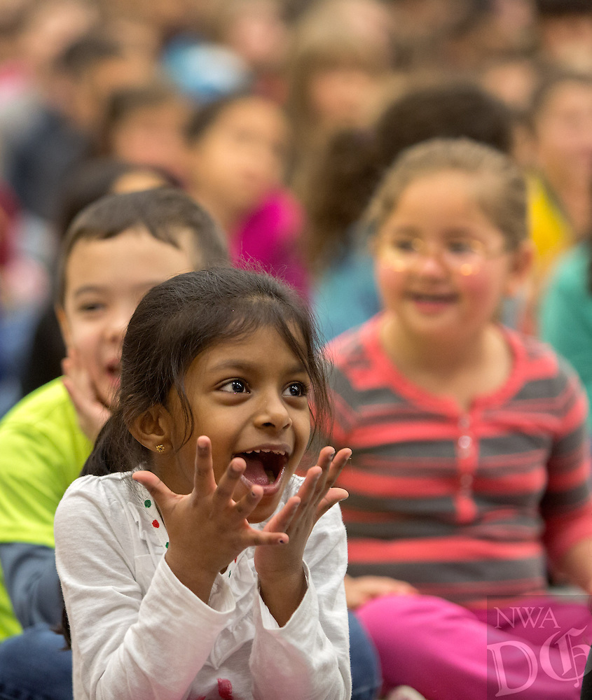 NWA Democrat-Gazette/JASON IVESTER --01/30/2015--<br /> Apple Glen Elementary kindergartener Maliha (cq) Shaik (cq) watches a video along with other students introducing them to the book, &quot;The World According to Humphrey,&quot; during the kickoff for One District, One Book on Friday, Jan. 30, 2015, at the Bentonville school. Kindergarten through fourth-graders in the school district will read the same book with their families.