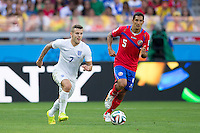 Jack Wilshere of England and Celso Borges of Costa Rica