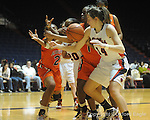 Auburn's Jordan Greenleaf (21), Mississippi's Kayla Melson, Auburn's Morgan Toles (1), and Mississippi's Elizabeth Robertson (14) battle for the ball in women's college basketball at the C.M. &quot;Tad&quot; SMith Coliseum in Oxford, Miss. on Thursday, February 25, 2010.