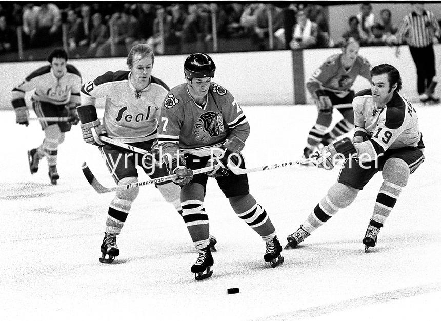 Seals vs BlackHawks 1971: Seals Stan Gilbertson and Bert Marshall battle Hawks Pit Martin..(photo/Ron Riesterer)