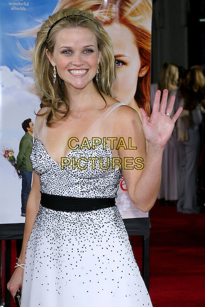 """REESE WITHERSPOON.At the Los Angeles Premiere of """"Just Like Heaven"""" held at Graumann's Chinese Theatre,.Los Angeles, 8th Septeber 2005.half length black white layer chiffon dress crystal earrings alice hair band belt wave waving.Ref: ADM/JW.www.capitalpictures.com.sales@capitalpictures.com.© Capital Pictures."""