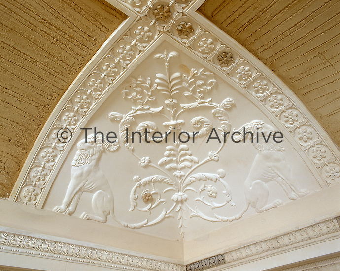 The unfinished restoration of this ceiling reveals the exquisite plasterwork detailing