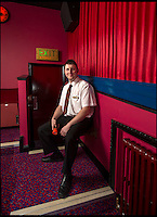 BNPS.co.uk (01202 558833)<br /> Pic: PhilYeomans/BNPS<br /> <br /> Andy has even fitted an original usherette seat.<br /> <br /> Field of Dreams....<br /> <br /> Film buff Andy Jones has built an ABC cinema in his back garden as a lasting tribute to the now defunct movie company.<br /> <br /> Andy, 38, has taken four and a half years and spent &pound;70,000 of his life savings building the 34-seat cinema from scratch.<br /> <br /> The father-of-two's movie house mirrors cinemas of the 1930s with big red curtains, red seats and a parquet floor in the projection room. <br /> <br /> The brick building, which is adorned with an ABC sign, is 40ft tall, 22ft wide and 20ft high and takes up half of the garden of his three bed semi-detached house.<br /> <br /> The theatre, which has a 17ft by 7ft screen, has its own projection room, black and white old-style toilets and a foyer with a concessions stand that offers popcorn and sweets.