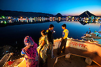The Pushkar Lake is surrounded by 52 bathing ghats. Every year on the full moon day in the month of Kartik (October/November), which also happens to be the last day of the world famous &quot;Pushkar Camel Fair&quot;, Pushkar Lake attracts thousands of pilgrims from all over the country to take a holy dip in its waters. It is believed that a dip in its waters cleanses all the sins and is the surest way to achieve salvation from the cycles of life.<br /> <br /> Prominent among the ghats are Gau Ghat, Brahma Ghat and Varah Ghat. Also called Main Ghat, Gau Ghat is the place from which ashes of Mahatma Gandhi were sprinkled into the lake. Brahma Ghat is believed to be the spot where Brahma himself is said to have worshipped. The Varah Ghat is famed to be the place where Vishnu, the preserver of the Hindu Trinity, appeared in the form of Varaha (a boar), third in the line of his nine incarnations.