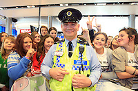 15/5/11 Fans joke with airport policeman while waiting for Jedward to arrive home at T2 Dublin Airport after finishing in 8th place at the Eurovision Song Contest in Dusseldorf, Germany. Picture:Arthur Carron/Collins