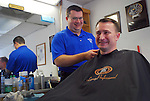 Local Barber Matt Dixon, cut the hair of director of the library, teacher and vice mayor, Stephen Bowling on Oct. 13th. Bowling has been coming to the shop for years, and the two have become close. .Photo by Sam Verbulecz