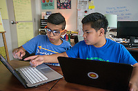 NWA Democrat-Gazette/ANTHONY REYES @NWATONYR<br /> Diego Soto (left), 12, and Hency Bungitak, 11, both sixth grade students at Hellstern Middle School, work on an online problem Monday, Feb. 27, 2017 during an after school study session at the school in Springdale. On this day, they were getting started on their homework list for the week.