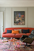 In the library a touch of 60's psychedelia comes from the vivid rug and the large sofa is actually Napoleon III recovered in a contemporary fabric; on the wall behind hangs a photographic print by Susan Wides
