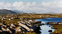 General view of landscape, near Cleggan, Connemara, Ireland. The beautiful landscape is crossed by a stream. In the background stands a remote farmhouse. Picture by Manuel Cohen
