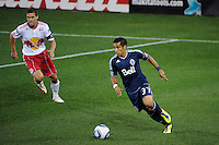 Camilo Sanvezzo (37) of the Vancouver Whitecaps is defended by Chris Albright (3) of the New York Red Bulls. The New York Red Bulls and the Vancouver Whitecaps played to a 1-1 tie during a Major League Soccer (MLS) match at Red Bull Arena in Harrison, NJ, on September 10, 2011.