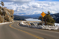 Historic US 40 passes over the Donner Summit at McGlashan Point on its way to Donner Lake and Truckee. The concrete arch bridge was completed in 1925 and served as the major east-west transcontinental route between San Francisco, California, and Atlantic City New Jersey until it was replaced by Interstate 80 in the mid 1960's. Today the road is a scenic bypass to the busy interstate and an access road to nearby ski resorts. Photographed December, 2006