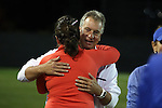 22 November 2013: Duke head coach Robbie Church (in white) embraces Florida head coach Becky Burleigh (in orange) before the game. The University of Florida Gators played the Duke University Blue Devils at Koskinen Stadium in Durham, NC in a 2013 NCAA Division I Women's Soccer Tournament Second Round match. Duke won the game 1-0.