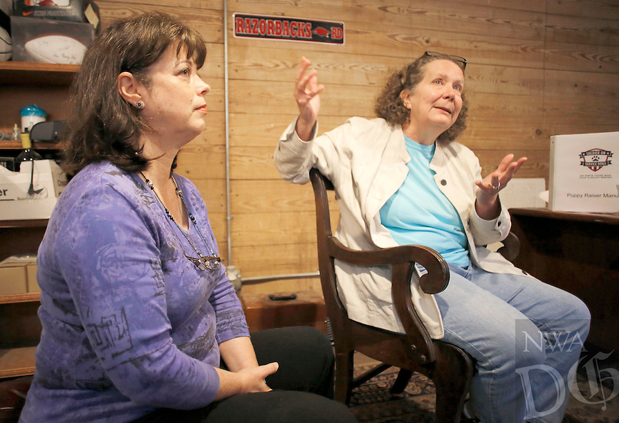 NWA Democrat-Gazette/DAVID GOTTSCHALK  Elise Burt (left), veterans program manager, and Angie Pratt, executive director, discuss Thursday, May 19, 2016, the positive affect dogs involved in Soldier On Service Dogs have on the lives of veterans.